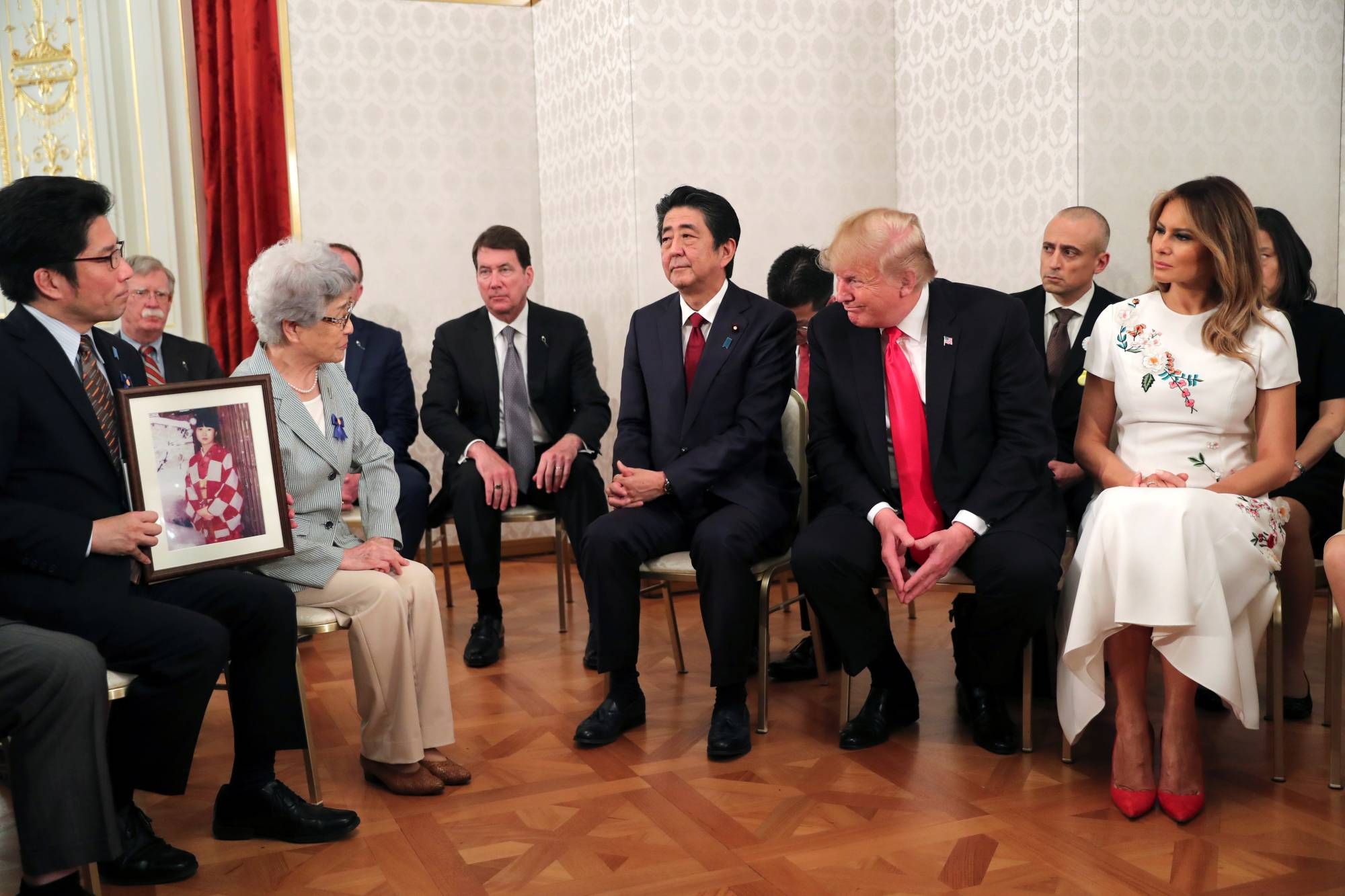 Prime Minister Shinzo Abe, U.S. President Donald Trump and first lady Melania Trump meet with family members of people abducted by North Korea in Tokyo in May 2019.    REUTERS