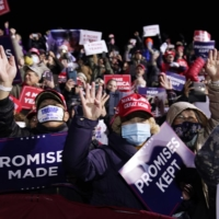 Supporters wave as U.S. President Donald Trump arrives to speak at a campaign rally at an airport in Montoursville, Pennsylvania, on Saturday.  | AP