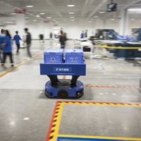 A delivery robot moves through the Xunxi factory in Hangzhou, China. | BLOOMBERG