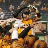 The Giants' Yoshihiro Maru celebrates after hitting a home run on Saturday at Tokyo Dome. | KYODO