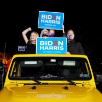 Supporters of U.S. Democratic presidential candidate Joe Biden and vice presidential nominee Kamala Harris take part in a drive-in campaign rally in Philadelphia on Sunday. | REUTERS