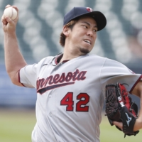 Twins starter Kenta Maeda throws against the Tigers on Aug. 30 in Detroit. Maeda has been nominated for the AL Cy Young Award after going 6-1 in 11 starts. | USA TODAY / VIA REUTERS