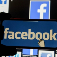 Social media sites including Facebook suspended several recently created right-leaning news accounts posting information about voting for violating their policies. | REUTERS