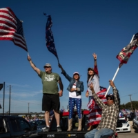 Trump supporters gather before driving in a caravan in San Antonio, Texas, on Sunday. | TAMIR KALIFA / THE NEW YORK TIMES
