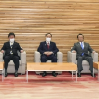 Prime Minister Yoshihide Suga attends a Cabinet meeting on Wednesday. | KYODO