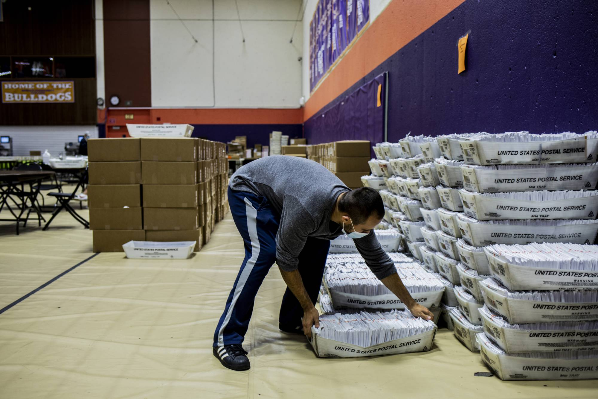 A Bergen County ballot board official moves mail-in ballots on Monday in a gym in Paramus, New Jersey. | BRYAN ANSELM / THE NEW YORK TIMES