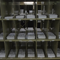 Mail-in ballots sit on shelves inside the Trumbull County Board of Elections on Tuesday in Warren, Ohio. | AP
