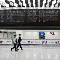 A flight arrival information board at Narita International Airport in Chiba Prefecture. Foreign nationals with valid residence statuses in Japan can apply for re-entry permission under guidelines for business travelers. | BLOOMBERG