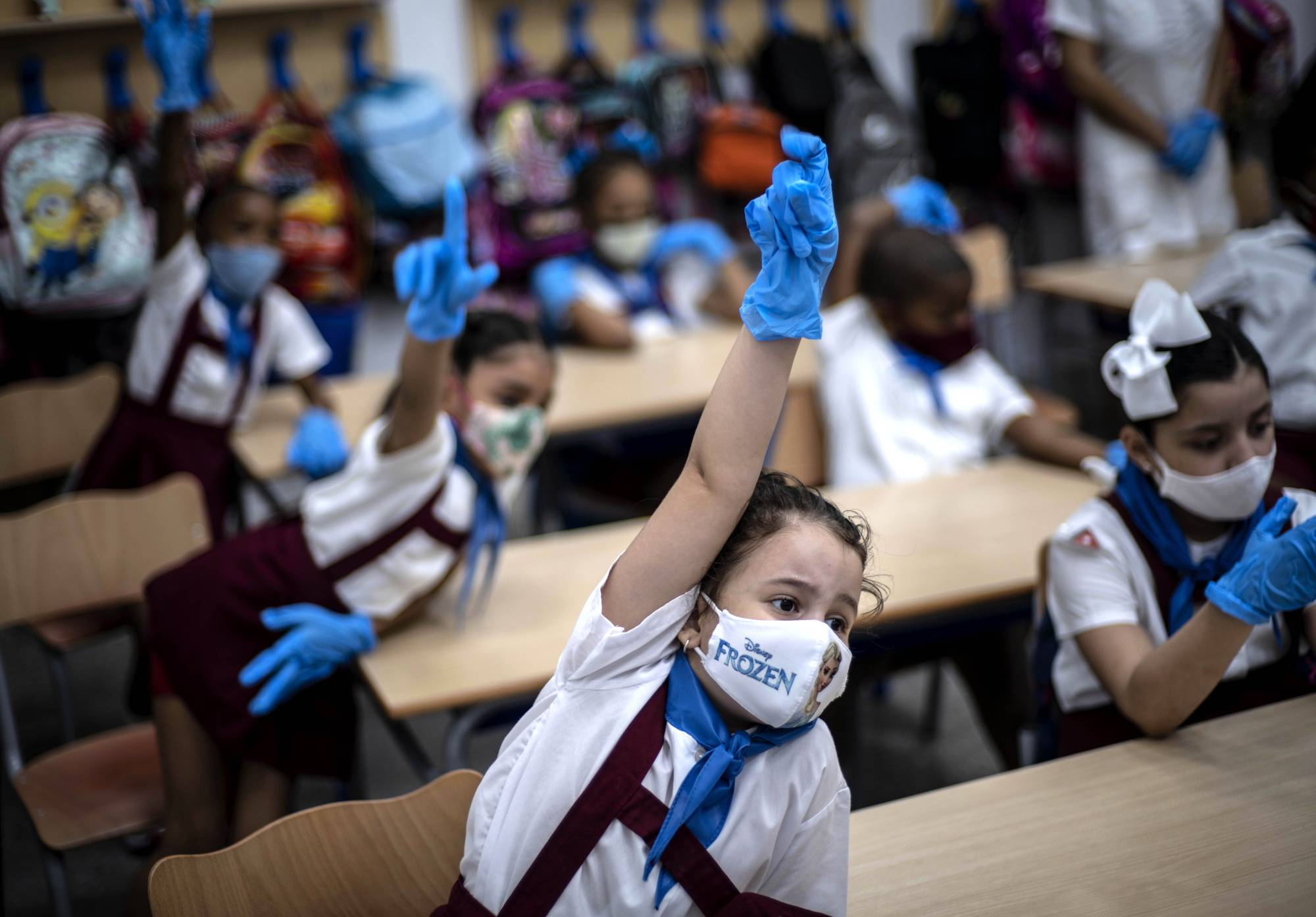 The ability of children to spread the virus is a matter of debate, and each country has dealt with its school students in different ways.   AP