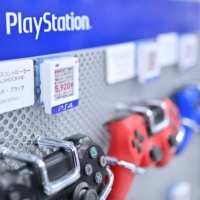 Sony Playstation 4 gaming controllers are sold at a store in Tokyo. Sony Corp. launches its PlayStation 5 console Nov. 12. | AFP-JIJI