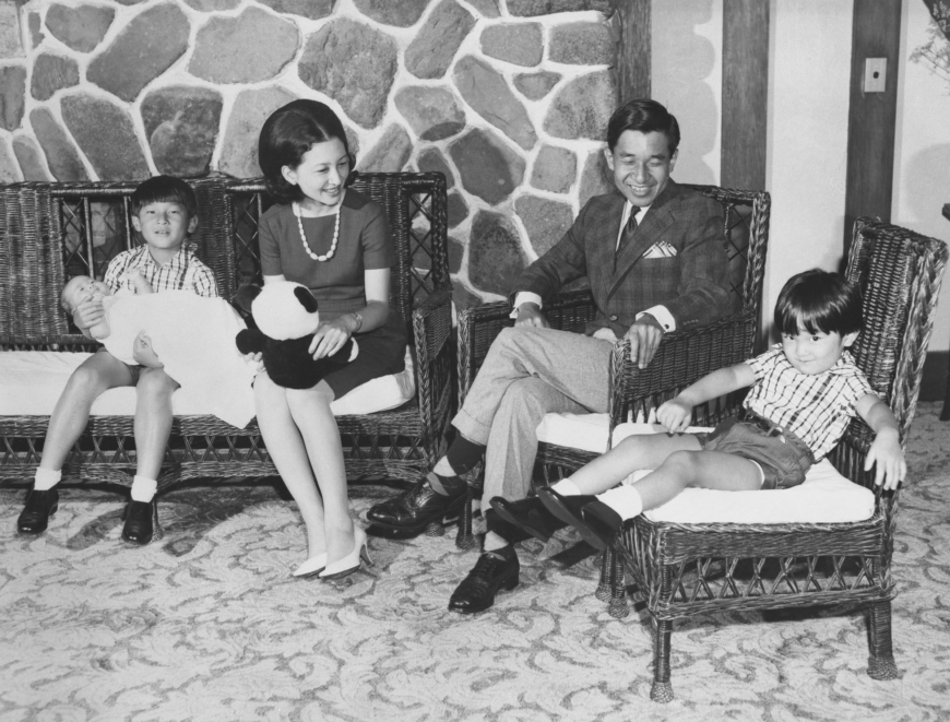 Crown Prince Akishino (far left) holds his younger sister and former Princess Sayako with Empress Emerita Michiko (second from left), Emperor Emeritus Akihito (second from right) and Emperor Naruhito sitting along with them on Aug. 12, 1969, in Karuizawa, Nagano Prefecture. | KYODO