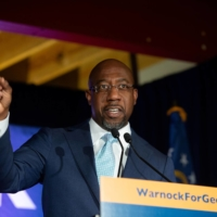 Democratic Senate candidate Rev. Raphael Warnock speaks during an Election Night event in Atlanta, Georgia, | REUTERS