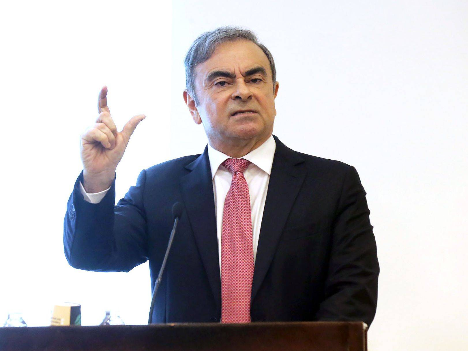 Carlos Ghosn, former chief executive officer of Nissan Motor Co. and Renault SA, gestures as he speaks to the media at the Lebanese Press Syndicate in Beirut in January. | BLOOMBERG