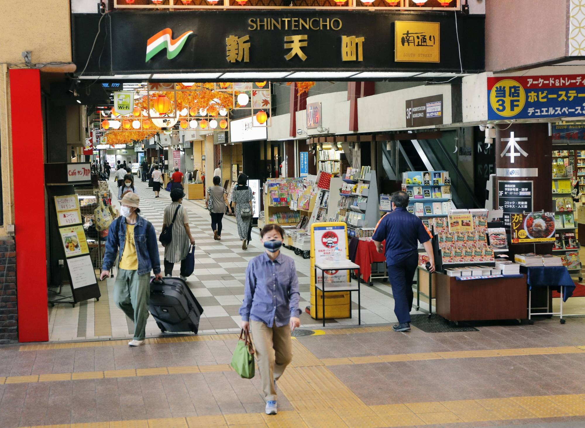 People walk in a shopping arcade in Fukuoka in September. Japan's household spending tumbled a real 10.2% in September from a year earlier. | KYODO