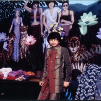Dream world: Iconic designer Kenzo Takada at his first Parisian show, Jungle Jap (later renamed Kenzo). The walls are illustrated with motifs from Henri Rousseau's 'The Dream.'  | KENZO TAKADA ARCHIVES