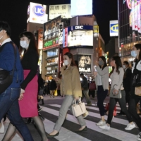 People walk in the Shibuya district of Tokyo on Oct. 29. | KYODO