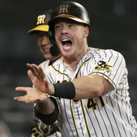 The Tigers' Justin Bour celebrates after hitting a home run against the Giants at Koshien Stadium in Nishinomiya, Hyogo Prefecture, on July 9. | KYODO