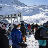 Skiers queue for the chairlift on the opening day of the Verbier ski area in the Swiss Alps on Oct. 30.  | KEYSTONE / VIA AP