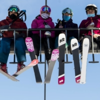 Skiers ride a chairlift on the opening day of the Verbier ski area in the Swiss Alps on Oct. 30.  | KEYSTONE / VIA AP