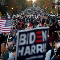 Celebrations erupted in Washington on Saturday after Joe Biden was declared winner of the U.S. presidential election.  | AFP-JIJI