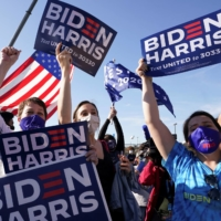 Supporters of U.S. President-elect Joe Biden celebrate in Wilmington, Delaware after news media declared Biden to be the winner of the presidential election.  | REUTERS