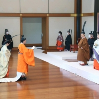 Crown Prince Akishino, standing along with Crown Princess Kiko in front of Emperor Naruhito and Empress Masako, vows to fulfillllll his duties at the Rikkoshi Senmei no Gi ceremony held Sunday at the Imperial Palace in Tokyo. | POOL / VIA KYODO