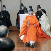 Crown Prince Akishino attends the Rikkoshi Senmei no Gi ceremony Sunday at the Imperial Palace. | POOL / VIA KYODO