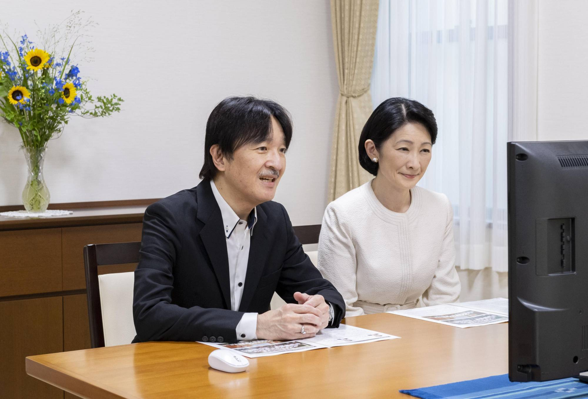 Crown Prince Akishino (left) talks with high school students online along with Crown Princess Kiko at their residence in Tokyo's Akasaka district in August. | IMPERIAL HOUSEHOLD AGENCY / VIA KYODO