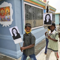 Indian children carry placards of U.S. Vice President-elect Kamala Harris during celebrations for her victory at a temple in Thulasendrapuram, the hometown of Harris' maternal grandfather.  | AP