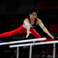 Kazuma Kaya competes in the men's parallel bars final during the 2019 World Artistic Gymnastics Championships in Stuttgart, Germany, on Oct. 13, 2019. | REUTERS