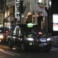 Drive safely: Taxis wait for customers at JR Nagoya Station. Their counterparts in Tokyo will now be allowed to refuse customers without masks. | KYODO
