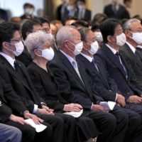 Prime Minister Yoshihide Suga (fifth from left) attends a memorial for Shigeru Yokota in Tokyo on Oct. 24 along with abductees' families including Shigeo Iizuka and Sakie Yokota. | KYODO