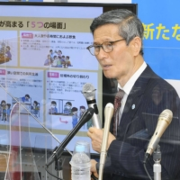 Shigeru Omi, head of a government panel of coronavirus experts, explains the panel's emergency proposals at a news conference in Tokyo Monday night. | KYODO