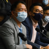 Pro-democratic Hong Kong legislators including Wu Chi-wai, Alvin Yeung and Lam Cheuk Ting give a news conference Monday as they threaten mass resignation amid reports that Beijing plans to disqualify some opposition lawmakers. | REUTERS