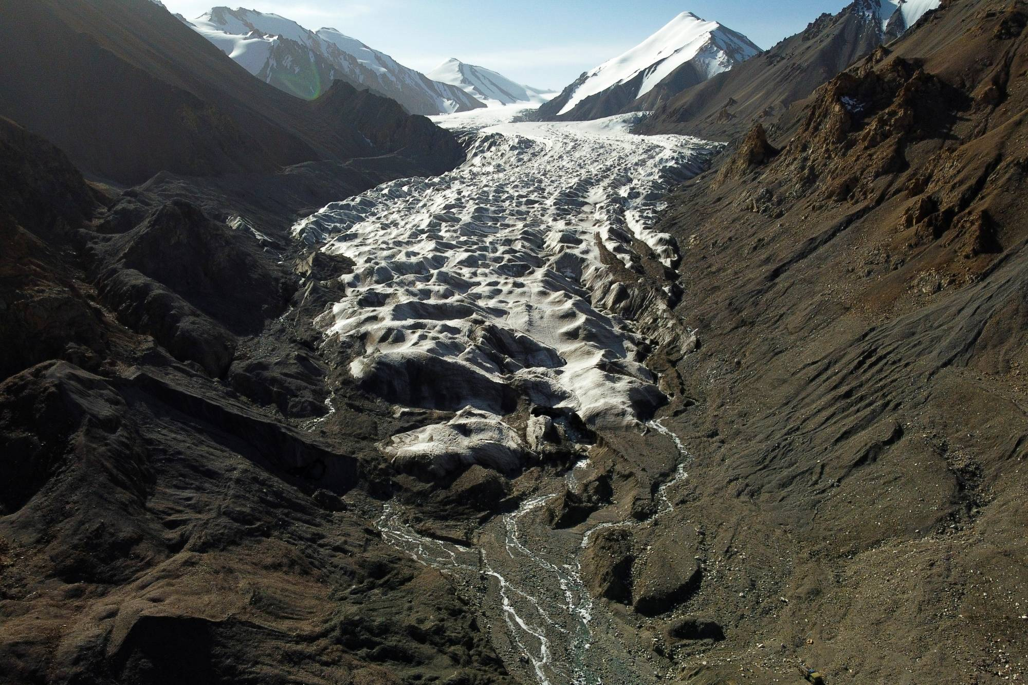 Meltwater from the Laohugou No. 12 glacier flows through the Qilian mountains in Subei Mongol Autonomous County in China's Gansu province. | REUTERS