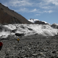 Jin Zizhen, a doctoral student of glacial hydrology, and Qin Xiang, the director of the Qilian Shan Station of Glaciology and Ecologic Environment of the Chinese Academy of Sciences, walk toward the Laohugou No. 12 glacier. | REUTERS