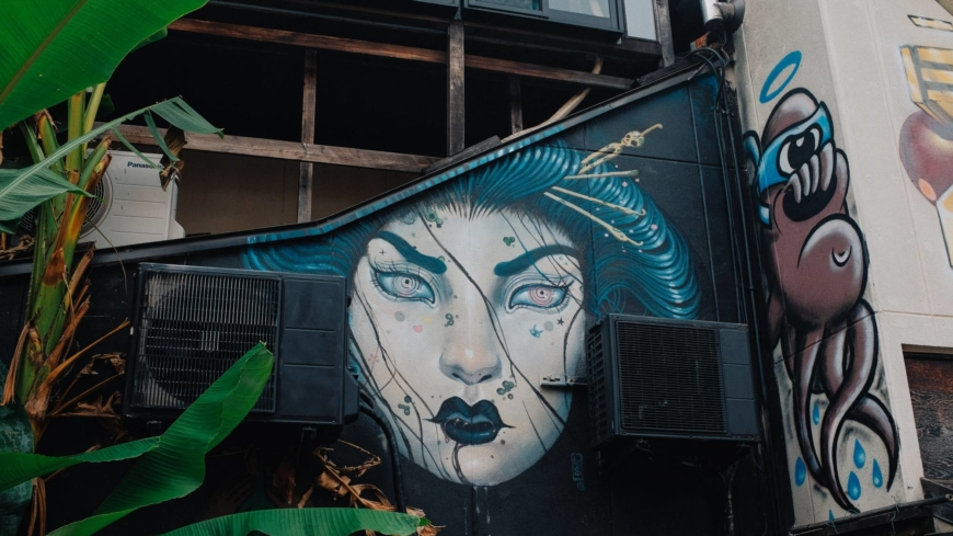 A street mural looks out at passers-by in the Harajuku neighborhood of Tokyo.   STEPHAN JARVIS