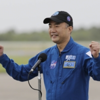 Astronaut Soichi Noguchi speaks during a news conference after he arrived at the Kennedy Space Center on Sunday. | AP