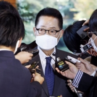 Park Jie-won, director of South Korea's National Intelligence Service, speaks to reporters at the Prime Minister's Office in Tokyo on Tuesday. | KYODO