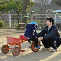 A male nursery teacher plays with a child at a day care center in the city of Chiba. |  KYODO