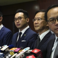 Lawmakers Dennis Kwok (left to right), Alvin Yeung, Kwok Ka-ki and Kenneth Leung give a news conference at the Legislative Council in Hong Kong on Wednesday. | AP