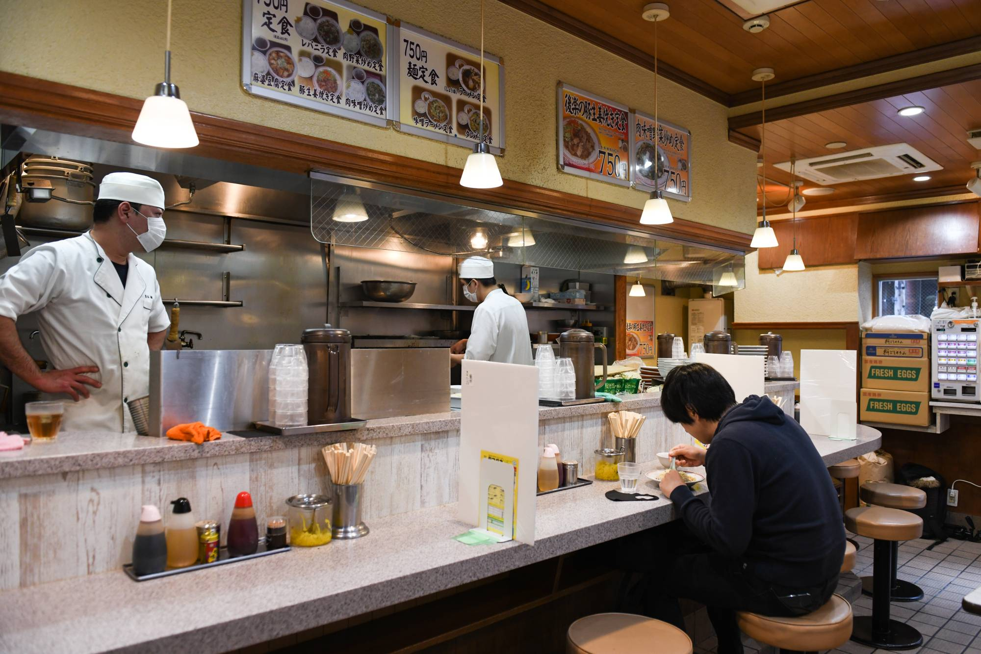 Ramen King Kouraku Honpo noodle store in Tokyo. Small restaurants operators like Kouraku Honpo are among the businesses hardest hit by the COVID-19 pandemic as they struggle to price in social-distancing limitations on capacity. | BLOOMBERG