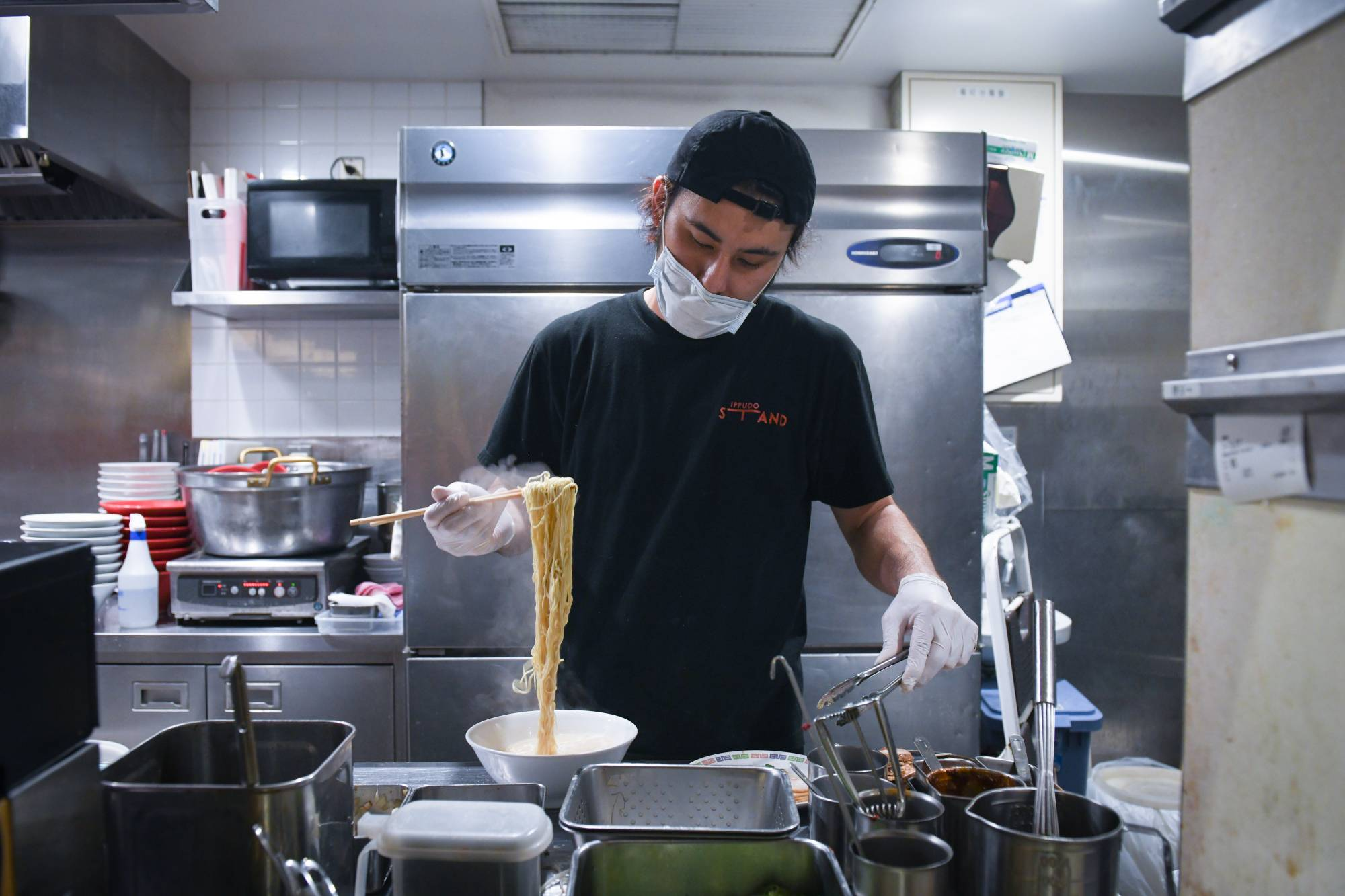 A chef prepares a bowl of ramen at an Ippudo ramen store in Tokyo. | BLOOMBERG