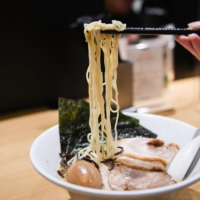A customer eats a bowl of ramen at an Ippudo outlet in Tokyo. | BLOOMBERG