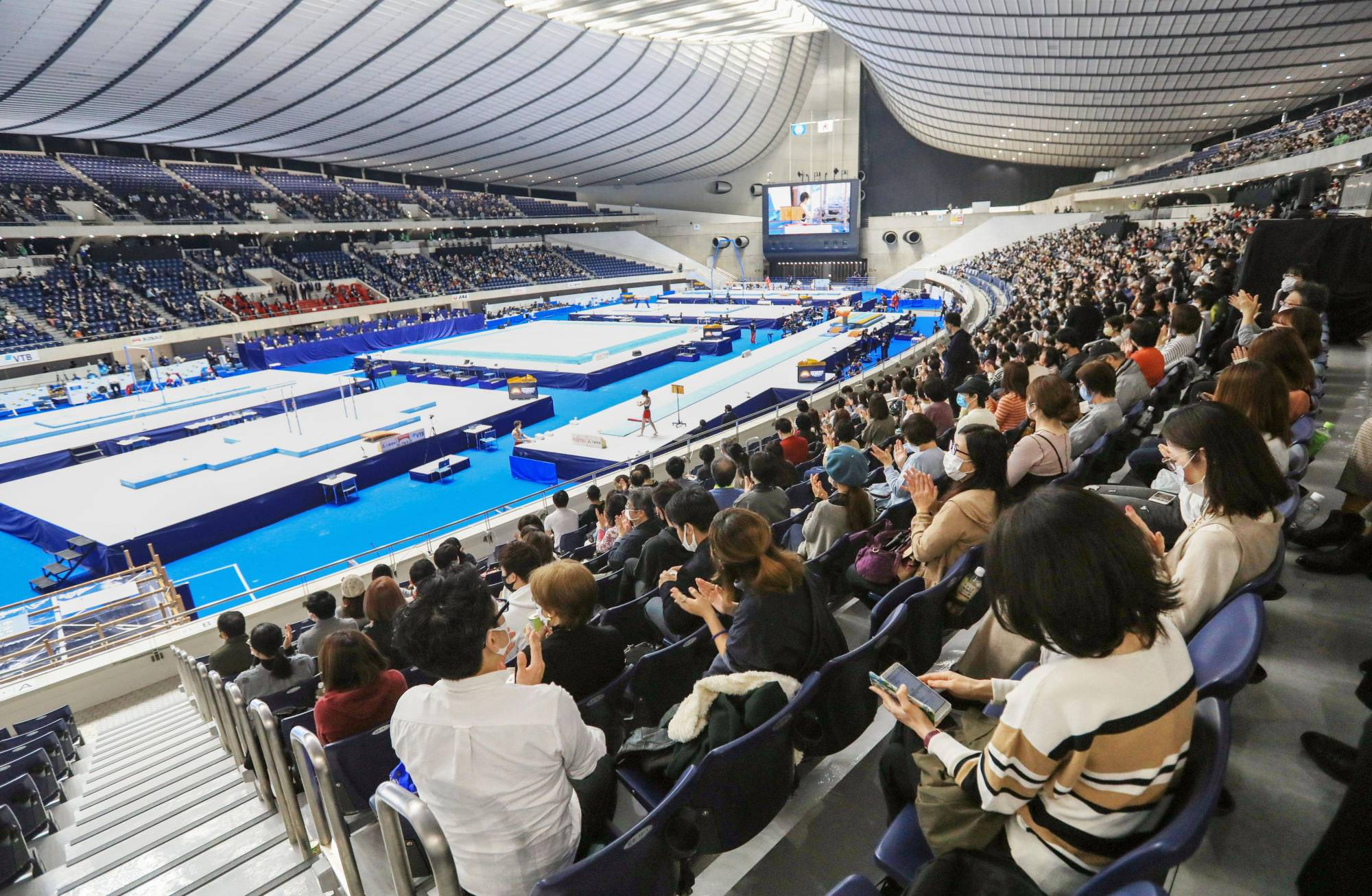 Spectators watch the gymnastics competition in Tokyo on Sunday. | KYODO