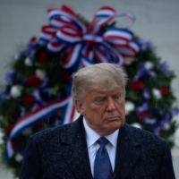 U.S. President Donald Trump attends a remembrance ceremony for war veterans on Wednesday in Arlington, Virginia.  | AFP-JIJI