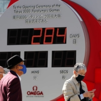 A clock in Tokyo counts down the days until the postponed Tokyo 2020 Paralympic Games on Friday. | REUTERS