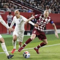 Vissel's Andres Iniesta dribbles around Johor players during an Asian Champions League group-stage game on Feb. 12 in Kobe. Results including the Malaysian club will be invalidated after it formally withdrew from the competition on Friday. | KYODO