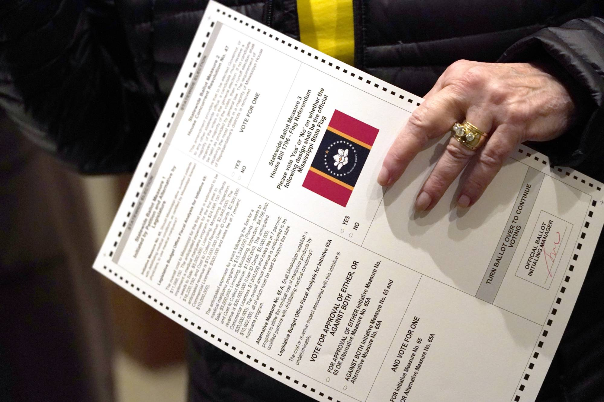 A voter holds a ballot during Election Day in Ridgeland, Mississippi, on Nov. 3.  In addition to the presidential race, the electorate in the state also voted on two medical marijuana initiatives. | AP