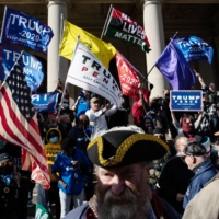 Supporters of U.S. President Donald Trump at the Michigan Capitol in Lansing on Nov. 7. Some Trump allies have suggested that Republican lawmakers should override the will of voters who elected Joe Biden the next president.  | BRYAN DENTON/THE NEW YORK TIMES